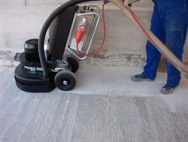 На фото - шлифование бетонной поверхности