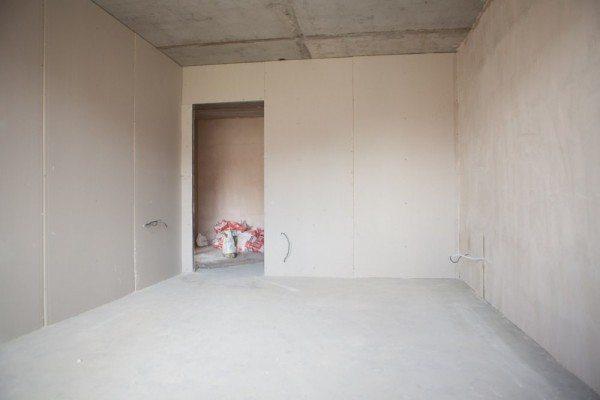 Отделка гипсокартоном позволяет получить практически идеально ровные стены