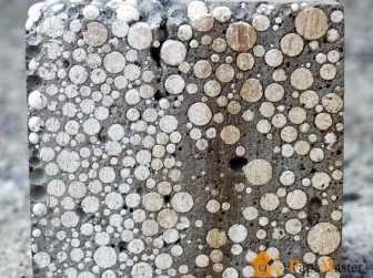 Внешний вид данного типа материла в разрезе, где можно наблюдать не только наличие капсул, но и раковин