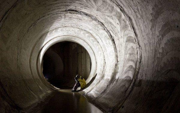 Внутри железобетонного канализационного коллектора.